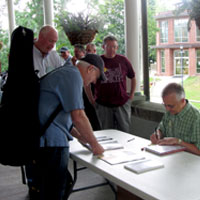 Fred Bartenstein signs copies of The Bluegrass Hall of Fame at Augusta Heritage Center's Bluegrass Week, Elkins, WV, July, 2015. (Photo: Donald Wermuth)